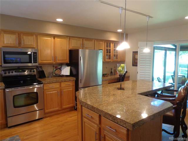 2730 S Heather Gardens Way, Aurora, CO 80014 (MLS #8694945) :: Bliss Realty Group