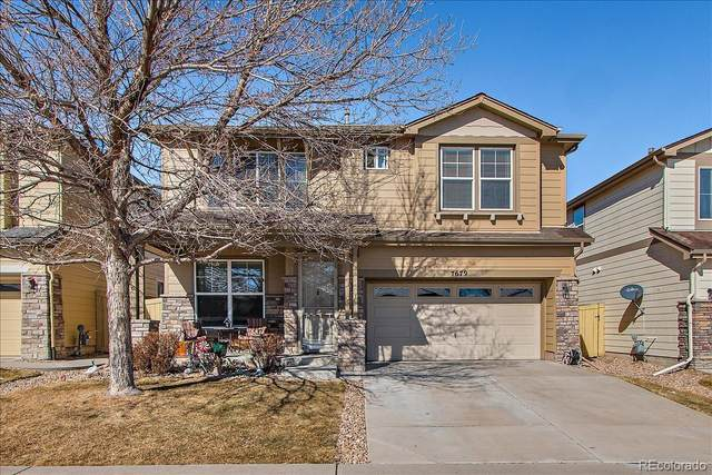 7679 W Grand Avenue, Littleton, CO 80123 (#8782351) :: Bring Home Denver with Keller Williams Downtown Realty LLC