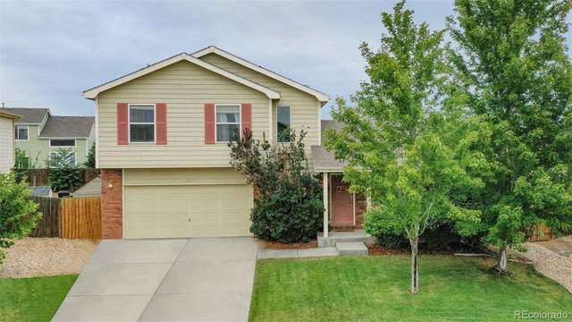 2117 Pioneer Drive, Milliken, CO 80543 (#8807193) :: Chateaux Realty Group