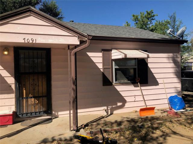 7091 Olive Street, Commerce City, CO 80022 (#8814378) :: The DeGrood Team