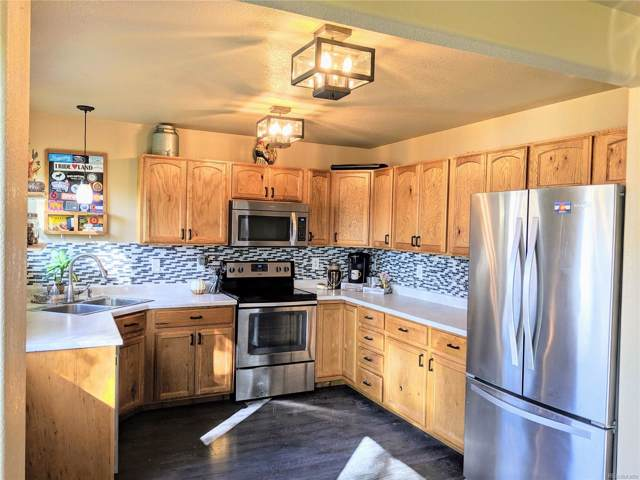 7001 Lee Street, Wellington, CO 80549 (MLS #8843497) :: Colorado Real Estate : The Space Agency
