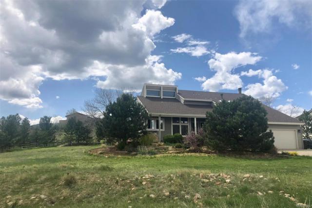 7011 Fairways Drive, Longmont, CO 80503 (MLS #8844881) :: Kittle Real Estate