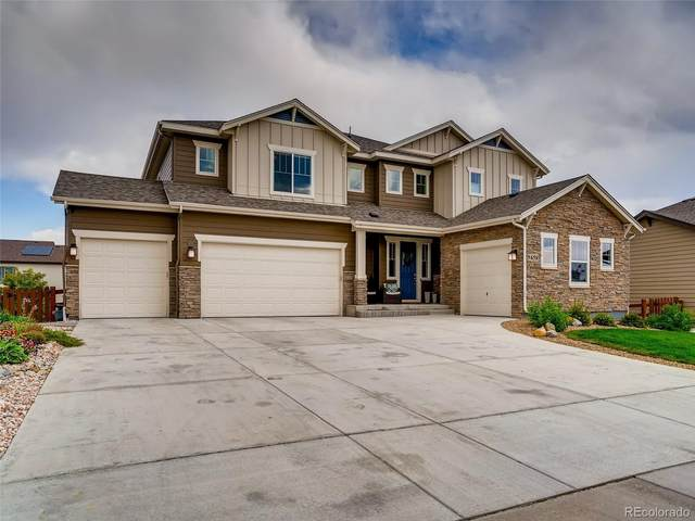 9458 Gore Loop, Arvada, CO 80007 (#8928475) :: The Healey Group