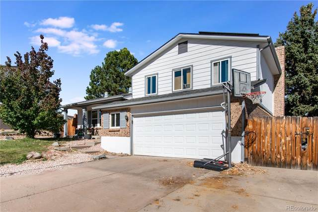 7609 S Holland Way, Littleton, CO 80128 (#8988111) :: The DeGrood Team