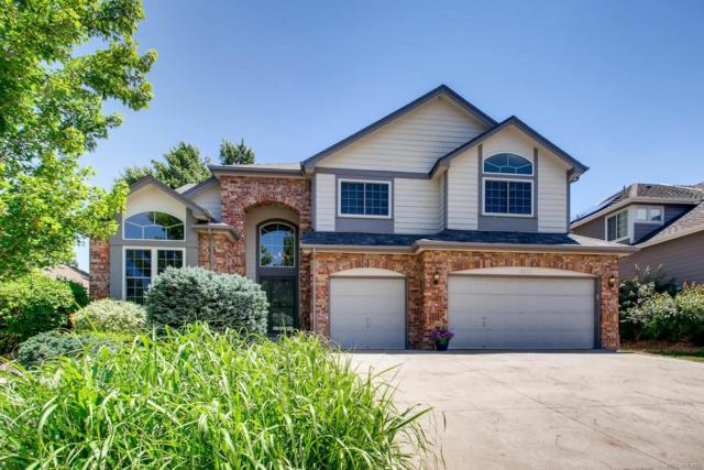 16272 W 66th Circle, Arvada, CO 80007 (#9027941) :: House Hunters Colorado