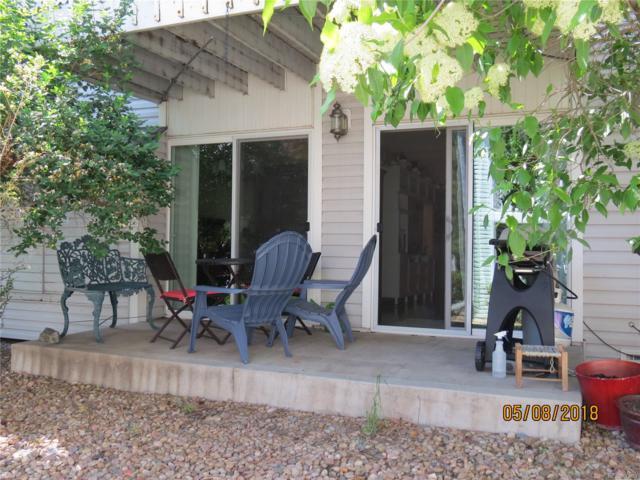 3343 S Monaco Parkway A, Denver, CO 80222 (#9038604) :: The Griffith Home Team