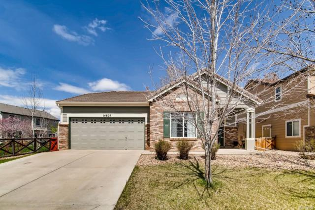 14807 E 118th Avenue, Commerce City, CO 80603 (#9059712) :: The Healey Group