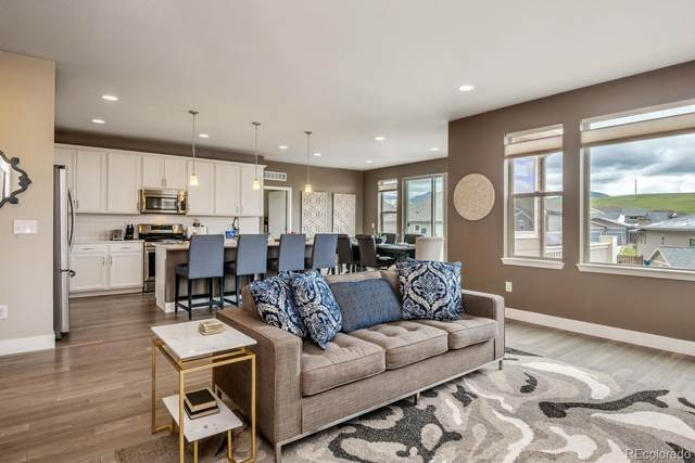 17379 W 94th Drive, Arvada, CO 80007 (#9067915) :: The Griffith Home Team