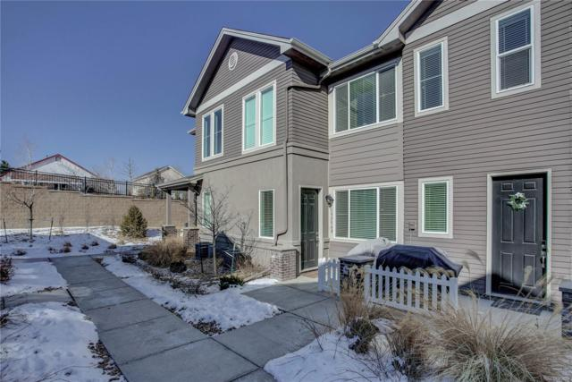 15556 W 64th Loop D, Arvada, CO 80007 (#9132860) :: The Griffith Home Team