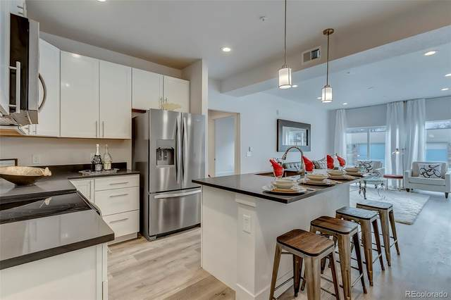 14936 E Hampden Avenue #101, Aurora, CO 80014 (#9136421) :: The Griffith Home Team