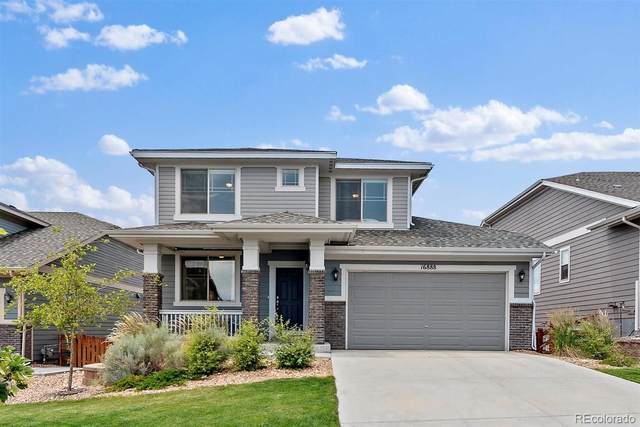 16888 W 87th Avenue, Arvada, CO 80007 (#9164742) :: The Healey Group
