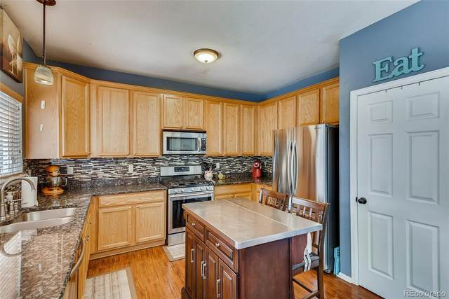 15936 E 97th Place, Commerce City, CO 80022 (MLS #9176237) :: 8z Real Estate