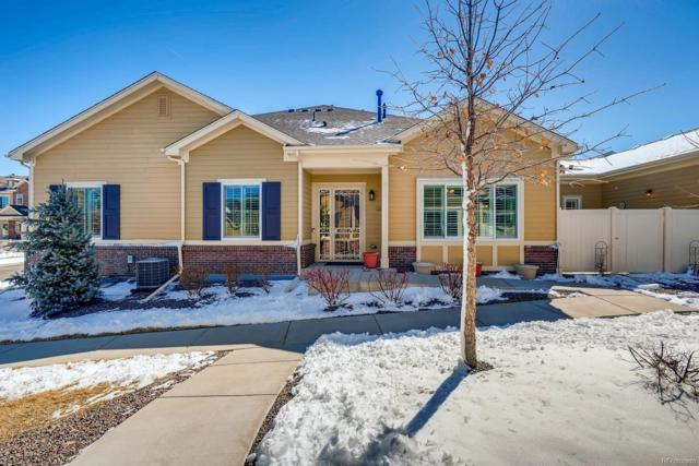 16085 W 62nd Lane F, Arvada, CO 80403 (#9213753) :: The Gilbert Group