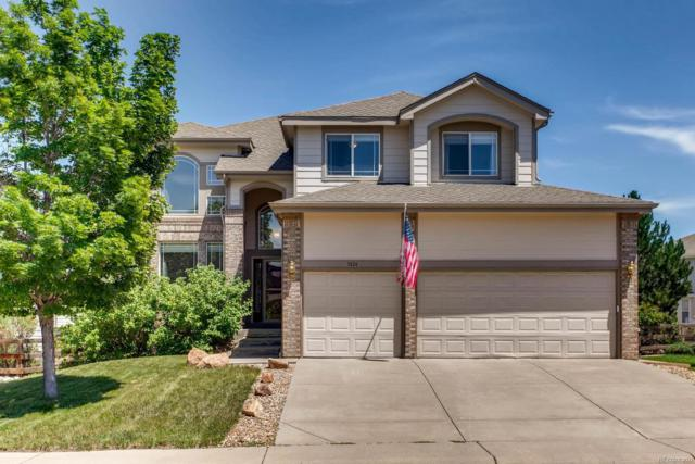 7434 Bison Place, Littleton, CO 80125 (#9350300) :: The Gilbert Group