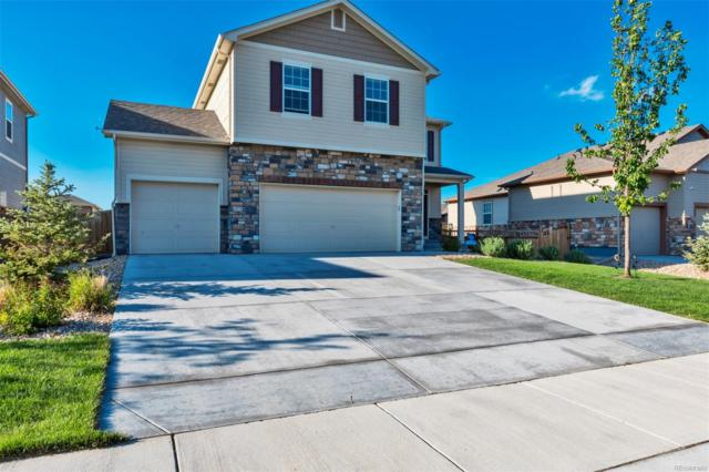 19407 E 65th Avenue, Aurora, CO 80019 (#9362422) :: James Crocker Team