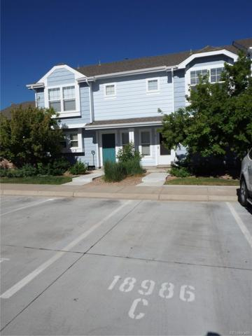 18986 E 57th Place C, Denver, CO 80249 (#9383974) :: The Healey Group