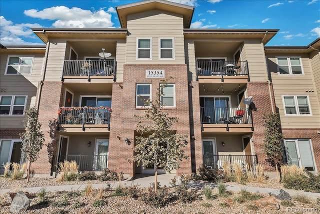 15354 W 64th Lane #204, Arvada, CO 80007 (#9390608) :: The HomeSmiths Team - Keller Williams