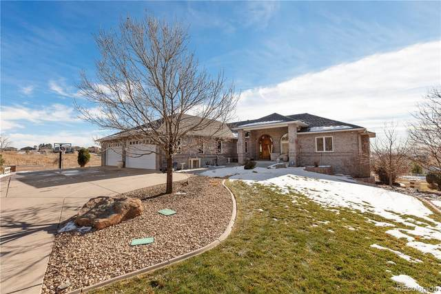 12896 W 81st Place, Arvada, CO 80005 (#9460351) :: The Healey Group