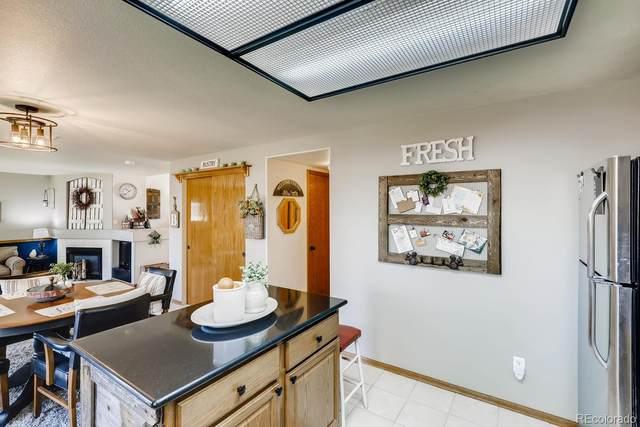 5235 E 128th Drive, Thornton, CO 80241 (MLS #9488301) :: Neuhaus Real Estate, Inc.