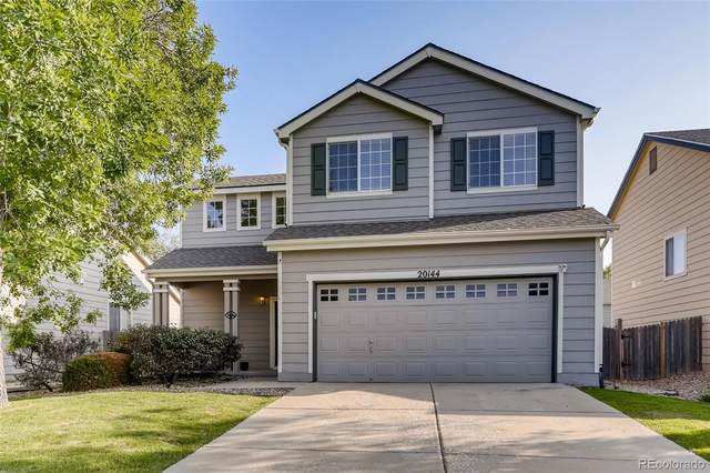 20144 E Ithaca Place, Aurora, CO 80013 (#9527634) :: Bring Home Denver with Keller Williams Downtown Realty LLC