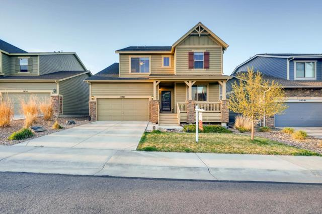 14521 W 85th Lane, Arvada, CO 80005 (#9531932) :: The DeGrood Team