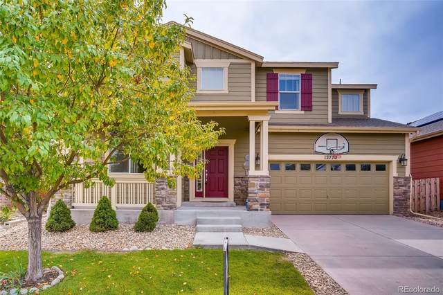 12772 E 105th Avenue, Commerce City, CO 80022 (#9539624) :: The Heyl Group at Keller Williams