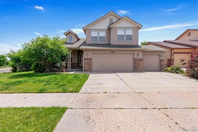 11736 E 119th Place, Henderson, CO 80640 (#9564809) :: Stephanie Fryncko | Keller Williams Integrity