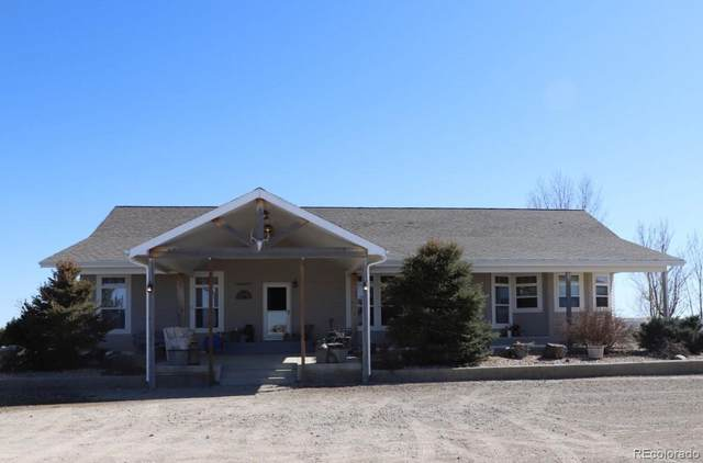 6104 County Road F, Wiggins, CO 80654 (#9618390) :: The DeGrood Team