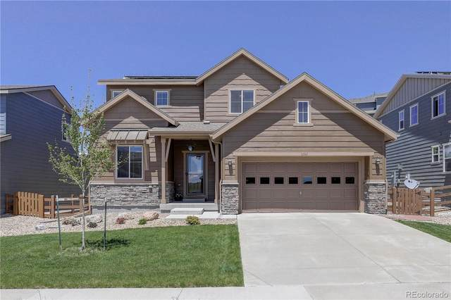 16545 W 94th Drive, Arvada, CO 80007 (#9634987) :: The Gilbert Group