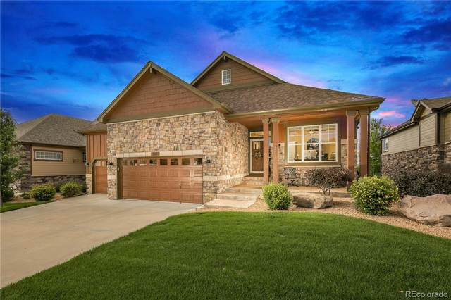 13883 W 87th Lane, Arvada, CO 80005 (#9651423) :: The DeGrood Team