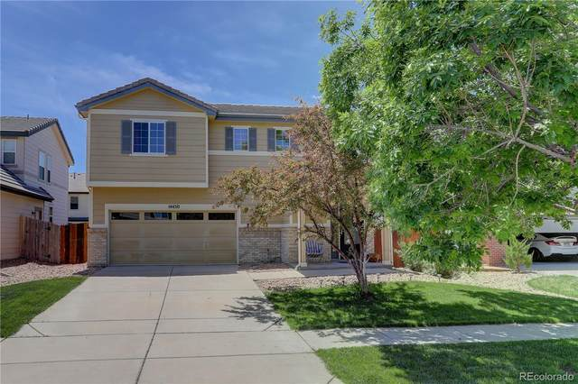 14450 E 102nd Avenue, Commerce City, CO 80022 (MLS #9698330) :: Bliss Realty Group