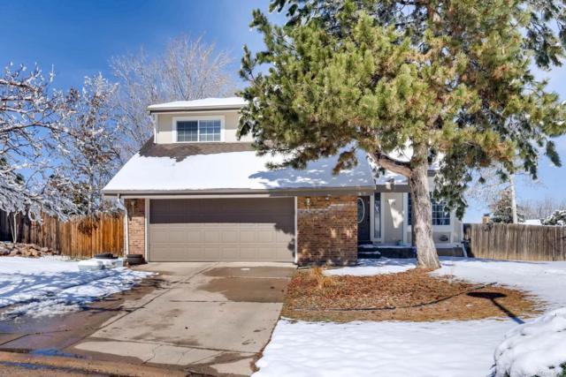 19926 E Greenwood Drive, Aurora, CO 80013 (#9725548) :: The Peak Properties Group