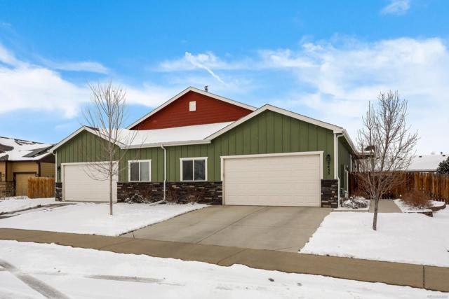 2455 School House Drive, Milliken, CO 80543 (#9804353) :: The Healey Group