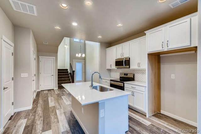 9727 Ash Lane, Thornton, CO 80229 (#9805014) :: Berkshire Hathaway HomeServices Innovative Real Estate