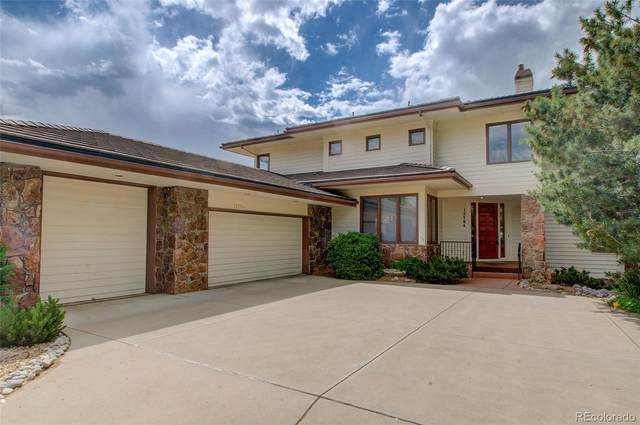15704 W 67th Place, Arvada, CO 80007 (#9809146) :: Bring Home Denver with Keller Williams Downtown Realty LLC
