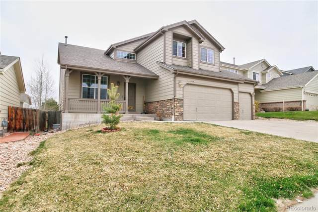 4424 S Himalaya Circle, Aurora, CO 80015 (#9839620) :: Hudson Stonegate Team