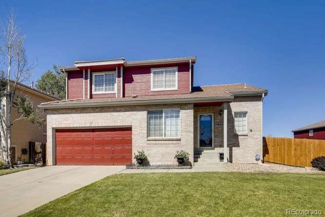 19545 E 40th Avenue, Denver, CO 80249 (#9854333) :: Ben Kinney Real Estate Team