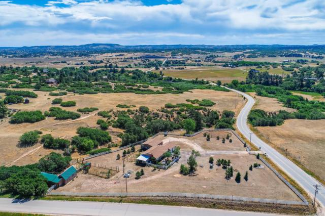 5227 Jackson Creek Road, Sedalia, CO 80135 (#9861810) :: The Peak Properties Group