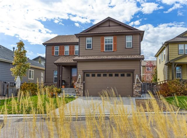 3155 Sweetgrass Parkway, Dacono, CO 80514 (#9868529) :: The Peak Properties Group