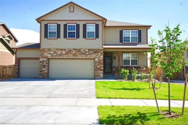 12652 E 104th Drive, Commerce City, CO 80022 (#9879381) :: The Peak Properties Group