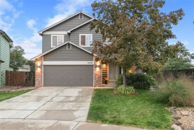 12291 N Holly Way, Brighton, CO 80602 (#9965185) :: The Peak Properties Group