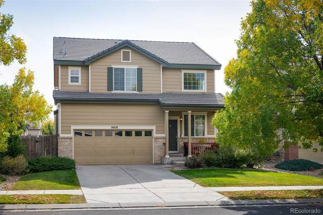14458 E 101st Place, Commerce City, CO 80022 (#9979809) :: The DeGrood Team