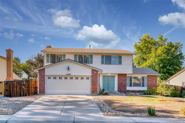 15067 E Greenwood Place, Aurora, CO 80014 (#1516303) :: You 1st Realty