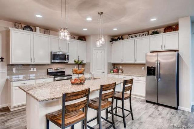 1390 S Coolidge Circle, Aurora, CO 80018 (#1566271) :: The HomeSmiths Team - Keller Williams