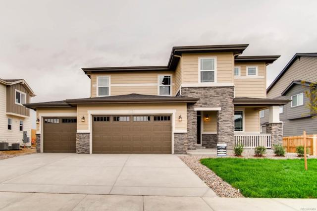 11721 E Ouray Court, Commerce City, CO 80022 (#1689446) :: The Peak Properties Group