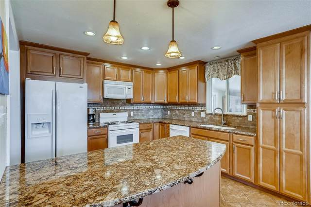 10480 W 14th Avenue, Lakewood, CO 80215 (#1693615) :: The DeGrood Team