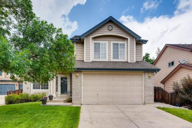 8765 S Cody Court, Littleton, CO 80128 (#1884532) :: The Galo Garrido Group