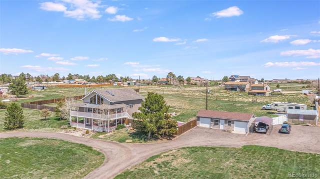 1030 S Gun Club Road, Aurora, CO 80018 (#2107210) :: Kimberly Austin Properties