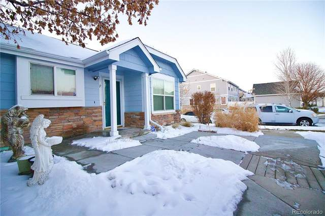 18986 E 57th Place F, Denver, CO 80249 (#2485685) :: iHomes Colorado
