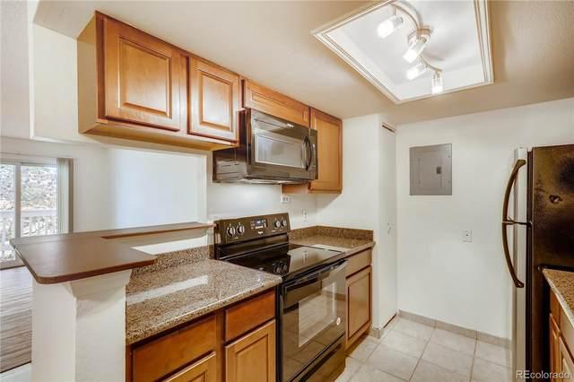 8555 Fairmount Drive J101, Denver, CO 80247 (#2962885) :: Wisdom Real Estate